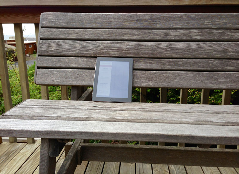 Photo: iPad showing The Magazine app, resting on a wooden bench