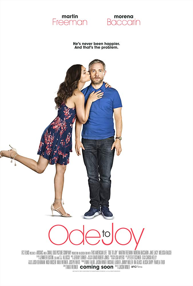 Movie poster for Ode to Joy. It shows Morena Baccarin kissing Martin Freeman on the cheek, in a joyful pose, while Martin Freeman stares at the camera seeming shocked.