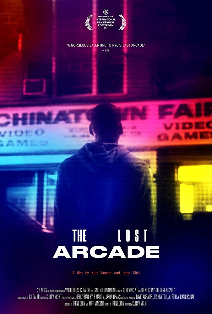 Movie poster for The Lost Arcade. It's a moody night-time image showing the back of a man as he looks toward the neon lights of the Chinatown Fair Arcade. Washes of neon color flow across the image.